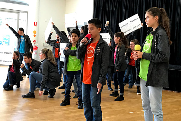 students singing on stage